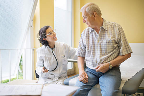 Doctor talking to a senior patient.