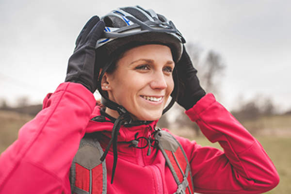 Woman wearing a bicycle helmet.
