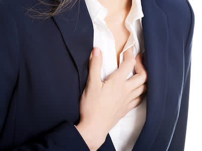 Business woman with chest pain.