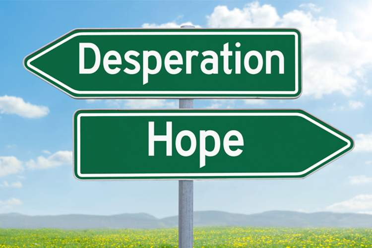 Hope and desperation signs pointing in opposite direction.