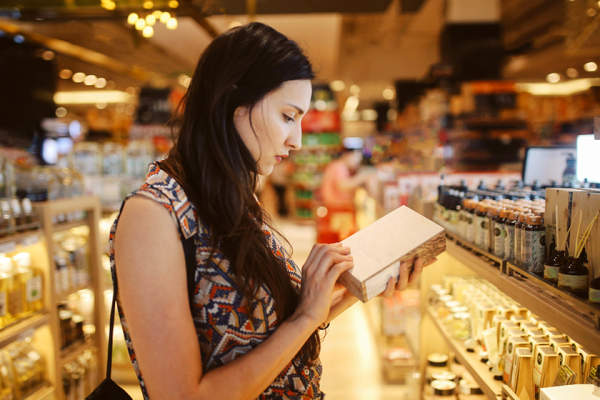 Young woman browsing through high-end products in department store