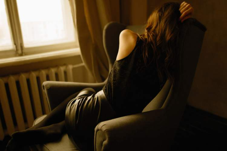depressed woman in chair