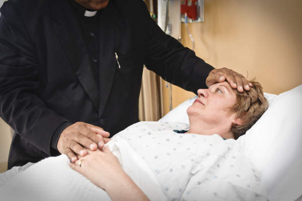 priest at hospice