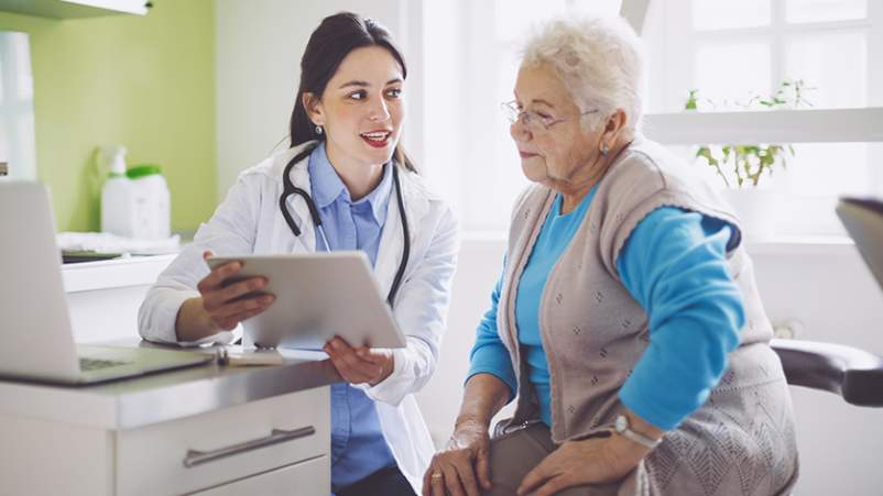 Doctor giving senior patient a memory test.