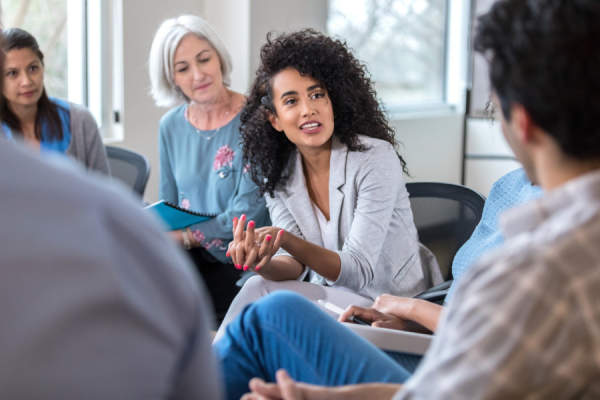 woman talking in support group