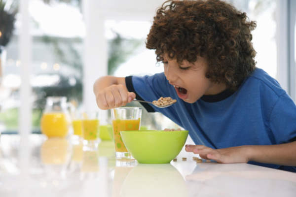 boy eating cereal image