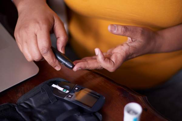 Woman checking her insulin levels