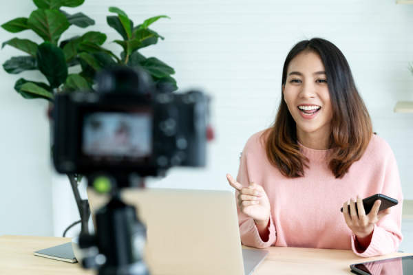 woman blogger or vlogger looking at camera and talking on video