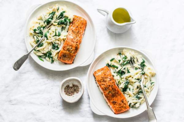 spinach orzotto, olive oil and baked salmon