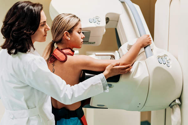 Young woman having a breast scan