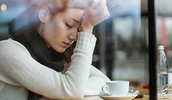 woman with anxiety in coffee shop image
