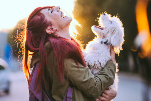 Woman and her dog, loving life concept.