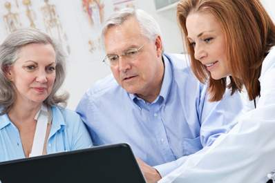 Doctor showing medical information to a senior couple.