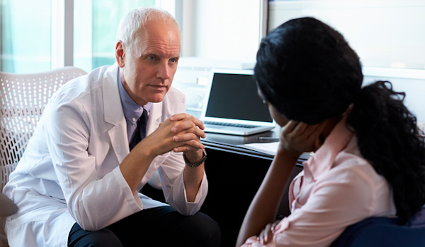 Woman in conversation with doctor.