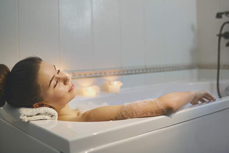 Woman relaxing in the bath.