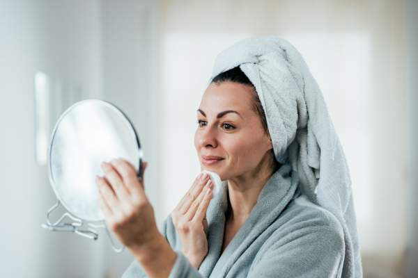mature woman cleaning skin