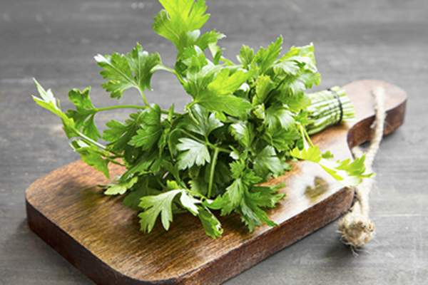 Parsley on a cutting board.