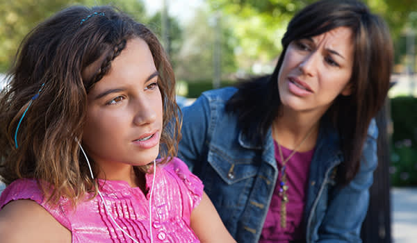 worried mother talking to teen daughter image
