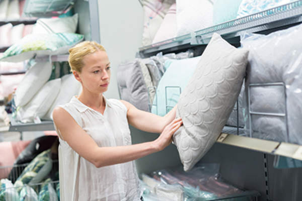 Woman shopping for a new pillow.