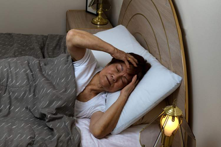 woman having trouble sleeping image