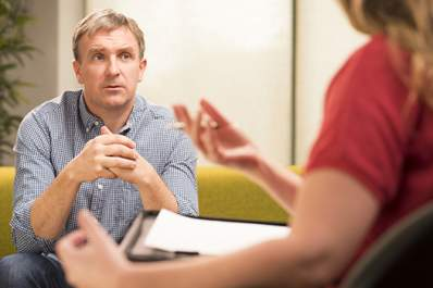 Man receiving cognitive behavioral therapy for anxiety.