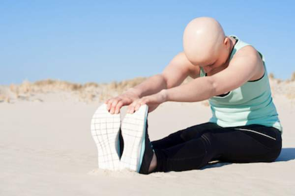 Stretching before working out after chemo.