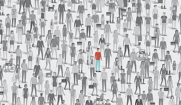 Person standing out in a crowd.