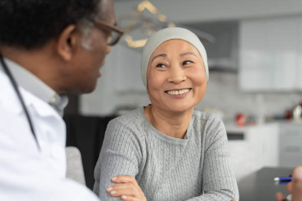 cancer patient talking to doctor