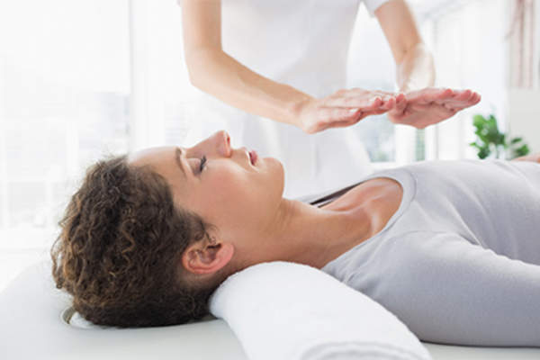 Woman having reiki treatment.