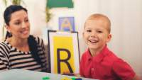boy with autism at speech therapy image