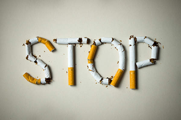 Stop spelled in cigarettes.