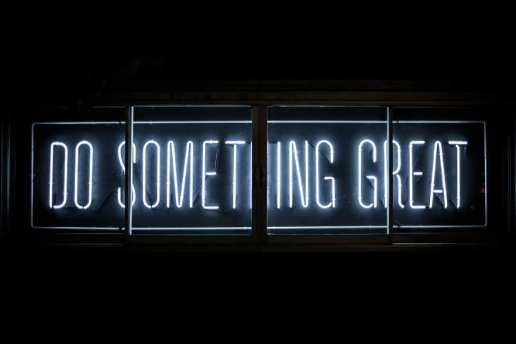 neon sign reading DO SOMETHING GREAT