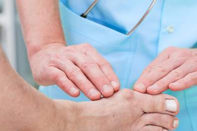 Podiatrist examines a patient's bunion.