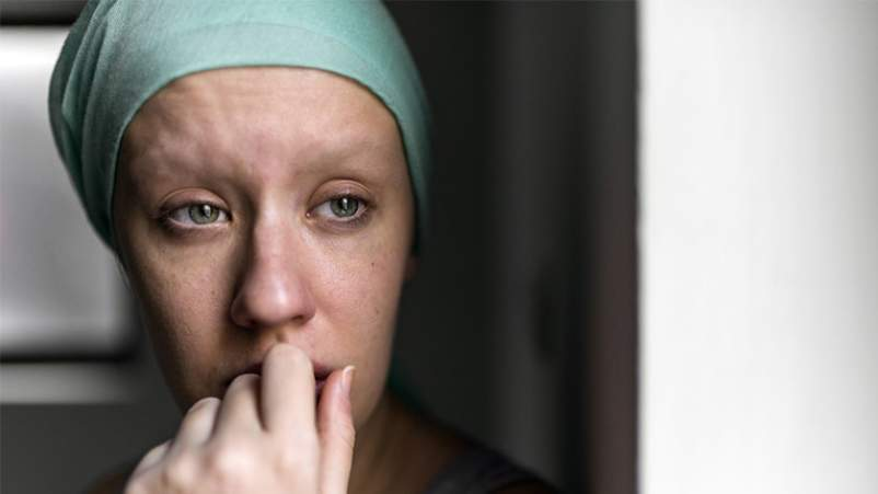 Sad woman with cancer.