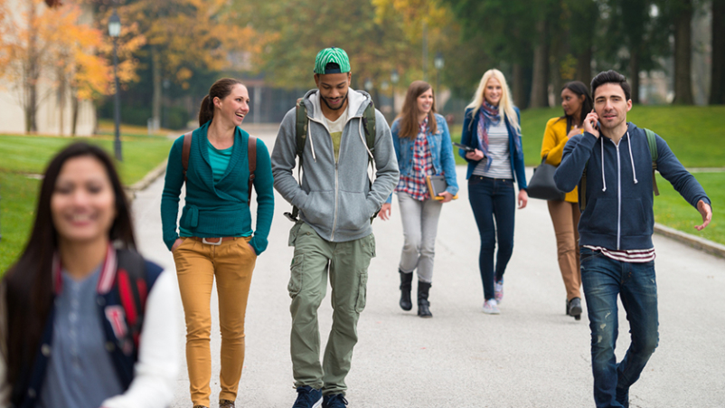 College students walking on campus.