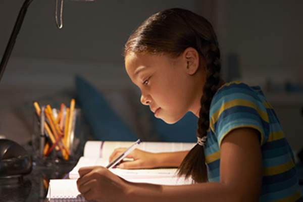Young girl doing homework.
