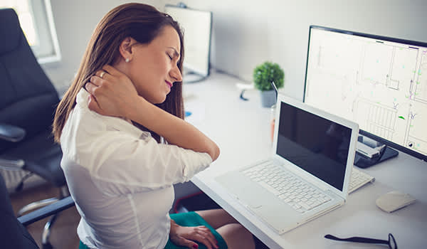 Woman with neck pain at work