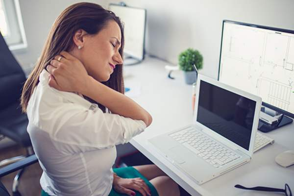 woman with neck pain image