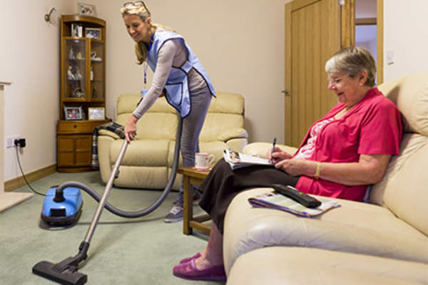 Woman helping with housework.