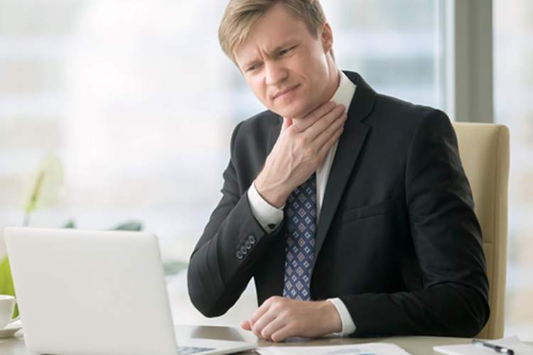 man with acid reflux image