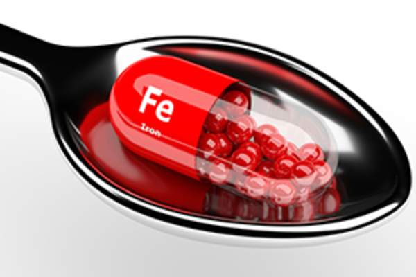 iron supplement on spoon image