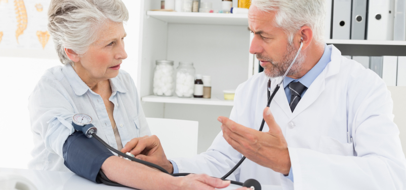 woman having blood pressure checked