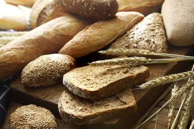 A selection of various breads and wheat.