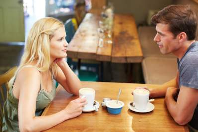 Couple having talk over coffee.