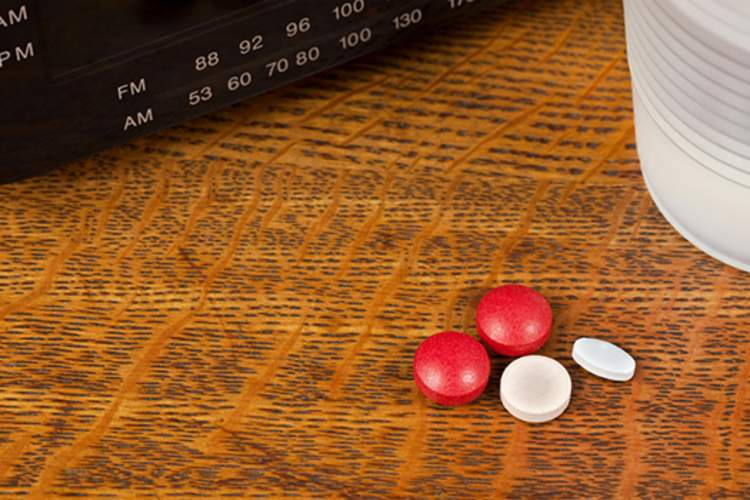 Pills on a nightstand