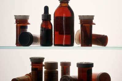 Indistinguishable Medcine bottles on medicine cabinet shelves