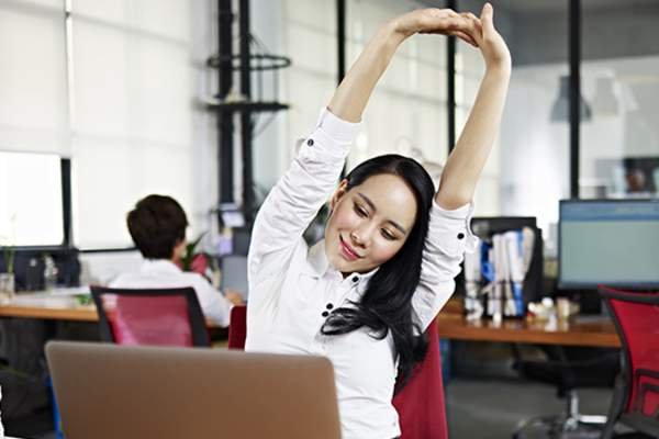 woman stretching at desk image