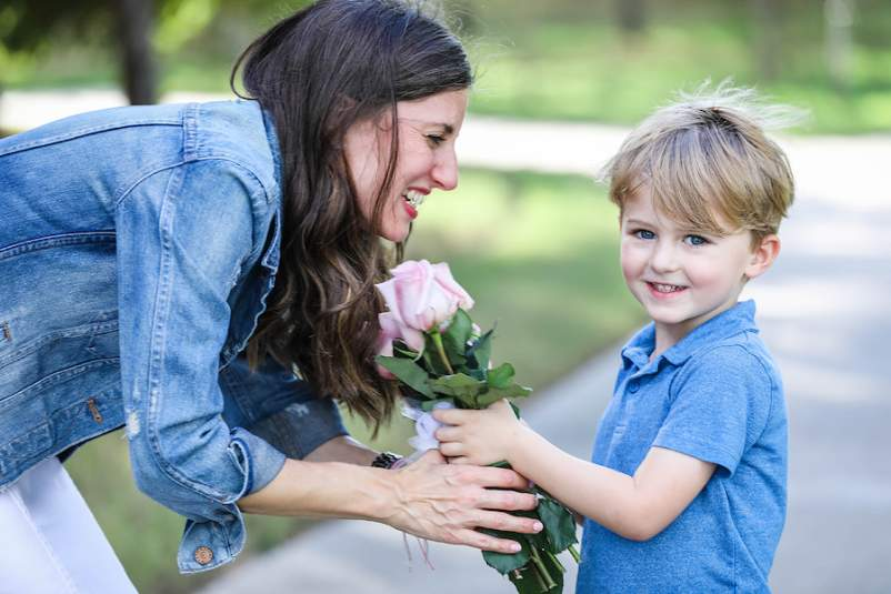 Sabrina Skiles and son with pink roses - Christy Murphy Photos