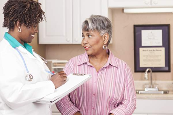 Senior woman talking to her female doctor.