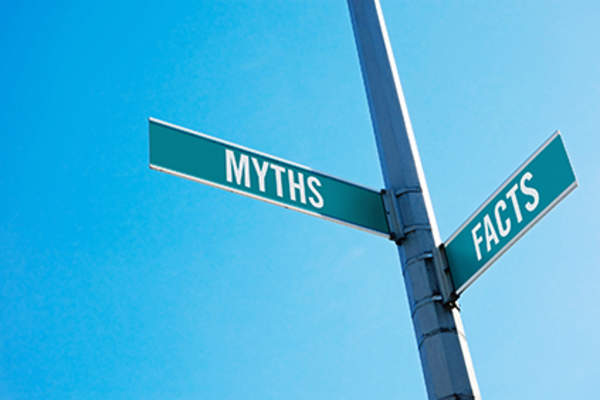 Street signs that point to myths and facts.